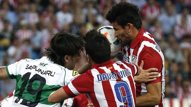 Liga - Atletico overcome nerves to beat Elche