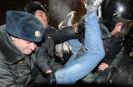 Russian riot police detain a protesters at Moscow's Pushkinskaya Square on March 5. The Russian opposition Tuesday defiantly vowed to wage a sustained campaign of protests after police detained hundreds in rallies against Vladimir Putin's crushing victory in presidential polls