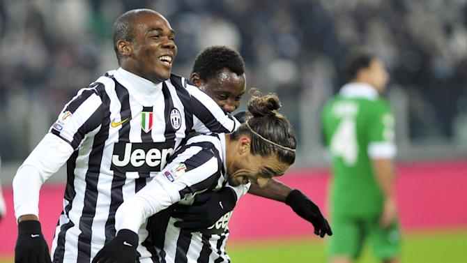 Juventus defender Martin Caceres, right, of Uruguay, celebrates with teammates after scoring during an Italian Cup soccer match between Juventus and Avellino at the Juventus stadium, in Turin, Italy, Wednesday, Dec. 18, 2013