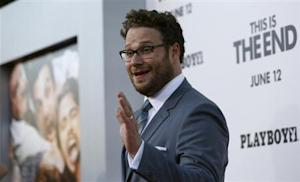 "Rogen waves at the premiere of ""This Is the End"" at the Regency Village Theatre in Los Angeles"