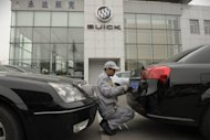 A mechanic works on a Buick at a General Motors (GM) dealership in Shanghai. US auto giant General Motors said Thursday that its China sales set a record for March, despite an overall slowdown in the world's biggest car market