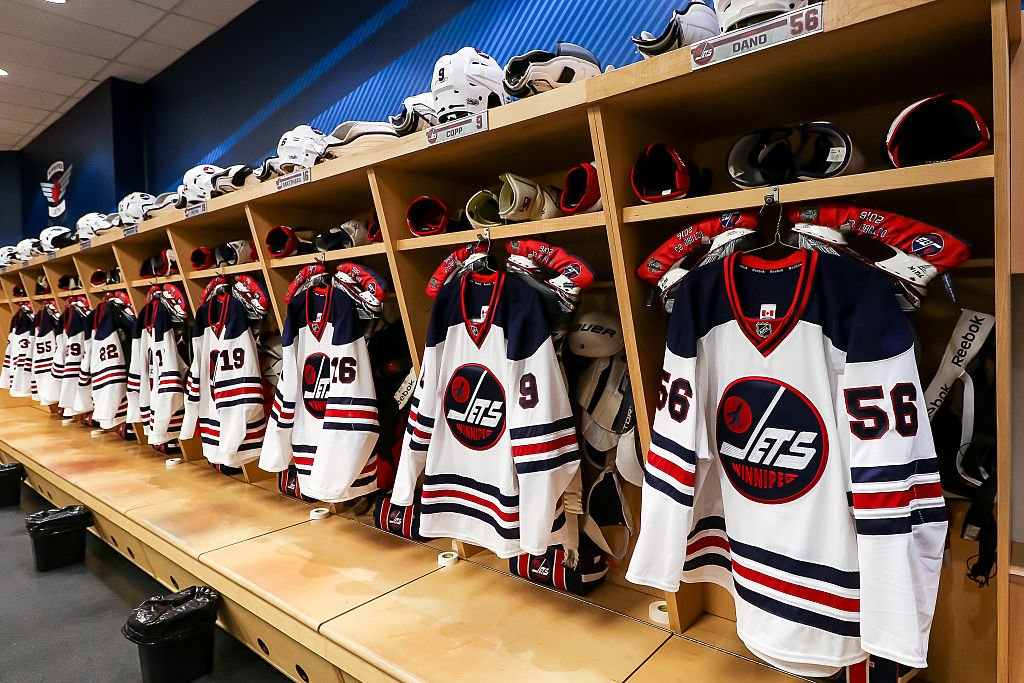 WINNIPEG, MB - JANUARY 9: Winnipeg Jets Heritage jerseys hang in the locker room prior to NHL action against the Calgary Flames at the MTS Centre on January 9, 2017 in Winnipeg, Manitoba, Canada. (Photo by Jonathan Kozub/NHLI via Getty Images)