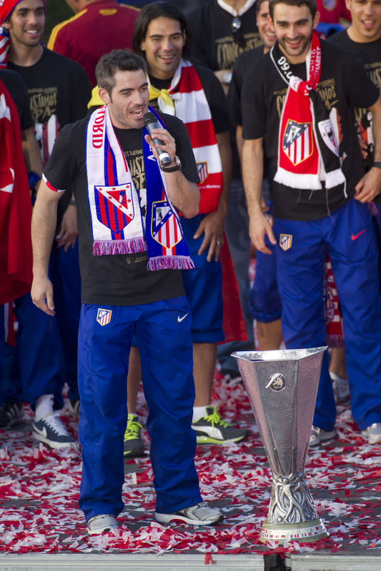 Atletico Madrid's Defender And Captain Antonio Lopez Speaks To Supporters At Neptuno Square In Madrid On May 10, 2012, AFP/Getty Images