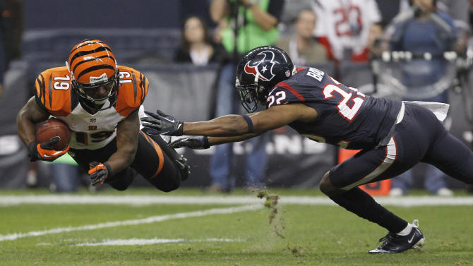 Cincinnati Bengals wide receiver Tate makes a catch in front of Houston Texans cornerback Ball during the third quarter of their NFL AFC wildcard playoff football game in Houston