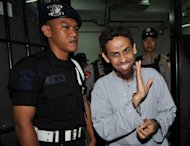 Indonesian terror suspect Umar Patek (right) is accused of being a central figure in attacks on two nightclubs in the Indonesian resort island of Bali -- which claimed the lives of 88 Australians -- and on churches in Jakarta on Christmas Eve in 2000
