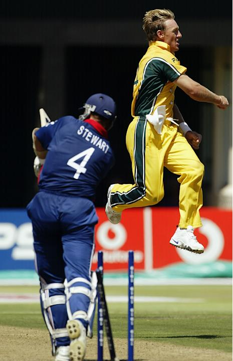Andy Bichel of Australia celebrates the wicket of Alec Stewart of England
