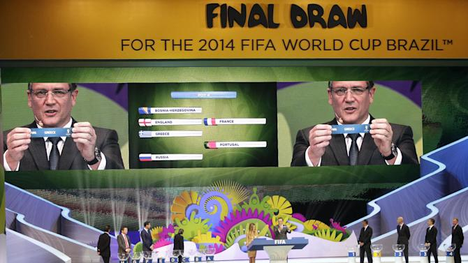 FIFA Secretary General Jerome Valcke holds the ticket of Greece during the draw ceremony for the 2014 soccer World Cup in Costa do Sauipe near Salvador, Brazil, Friday, Dec. 6, 2013