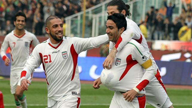 Asian Football - Iran, Qatar book Asian Cup places, China wait