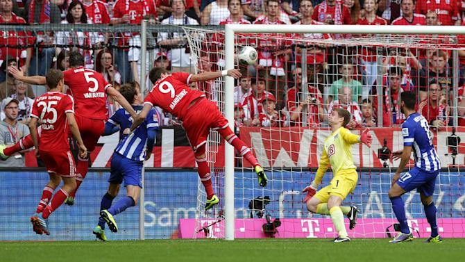 Bayern's Mario Mandzukic of Croatia (9) scores his side's first goal  during the German first division Bundesliga soccer match between FC Bayern Munich and Hertha BSC Berlin, in Munich, southern Germany, Saturday, Oct. 26, 2013