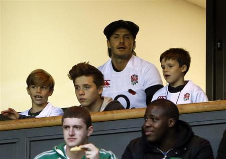 Former England footballer David Beckham (C) watches the international rugby union match between England and Argentina at Twickenham in London November 9, 2013. REUTERS/Stefan Wermuth