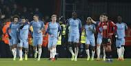 Britain Football Soccer - AFC Bournemouth v Manchester City - Premier League - Vitality Stadium - 13/2/17 Manchester City's Sergio Aguero celebrates scoring their second goal with teammates Reuters / Peter Nicholls Livepic