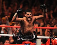 Carl Froch of Britain celebrates a win in Nottingham in May. Froch said Sunday that his world champion compatriot Amir Khan should think about retirement following his defeat by Danny Garcia in Las Vegas on Saturday night