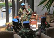 "Members of the UN Supervision Mission in Syria (UNSMIS) gather in the lobby of their hotel in Damascus. UN-Arab envoy Kofi Annan expressed ""horror"" at the Houla massacre of more than 100 people as he began a visit on Monday to the Syrian capital aimed at salvaging his battered peace plan"