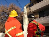 Saskatoon crews surveyed the big job ahead of them before attacking the giant icicle.