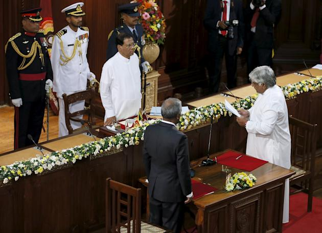 Sri Lanka's former cricket captain Ranatunga takes an oath as he is sworn in as a minister of ports and shipping in front of Sri Lanka's President Sirisena during the swearing in ceremony of n