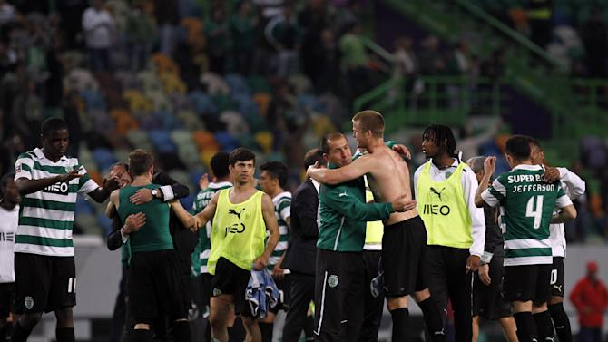 Sporting's coach Leonardo Jardim, fourth right, celebrates with teammates at the end of the Portuguese league soccer match between Sporting and Porto at Sporting's Alvalade stadium, in Lisbon, Sunday, March 16, 2014. Sporting won 1-0