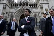 Ex-chairman of India's cricket IPL, Lalit Modi (C), leaves the High Court in central London on March 5, 2012, after a hearing in a libel case brought against him by former New Zealand cricketer Chris Cairns. Cairns has won the libel action, leaving Modi facing a bill of more than £500,000 ($794,000)