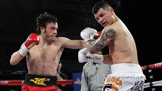 Boxing - Chavez Jr. routs Vera, Lomachenko fails in title attempt