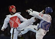 US athlete Paige Mcpherson (blue) fights against Great Britain's Sarah Stevenson during their women's taekwondo bout in the category under 67 kg as part of the London 2012 Olympic Games at the ExCel centre in London. Stevenson, who went into the Olympics heartbroken by the death of both her parents, will consider her future in taekwondo after crashing out in the first round