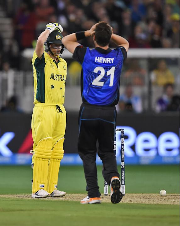 New Zealand's Matt Henry reacts after the ball hits the stumps but fails to dislodge the bails as Australia's Steve Smith was batting during the ICC Cricket World Cup final in Melbourne, Austr