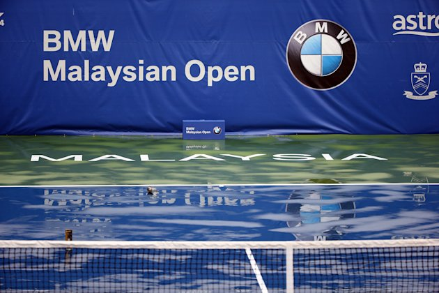 KUALA LUMPUR, MALAYSIA - APRIL 19: Play suspended due to bad weather during day two of the Malaysian Tennis Open at The Royal Selangor Golf Club on April 19, 2014 in Kuala Lumpur, Malaysia. (Photo by How Foo Yeen/Getty Images)