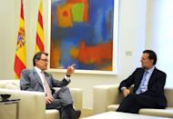 """Spanish Prime Minister Mariano Rajoy (right) listens to Catalonia's regional president Artur Mas during their meeting at the Moncloa palace in Madrid on September 20. Rajoy said there was """"no margin"""" for negotiations on letting the region raise and spend its own taxes."""