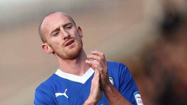 League Two - Talbot happy to stay at 'home'