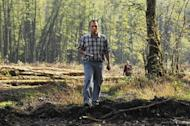 Suren Gazaryan walks in forest near the Sochi 2014 Winter Olympics site. Gazaryan is living in Estonia and says if he goes back to Russia he will be jailed by the officials whose illegal palaces he worked to expose