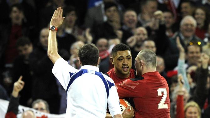 Wales' Taulupe Faletau celebrates scoring a try with team mate Ken Owens against Scotland during their Six Nations Championship rugby union match at the Millennium Stadium, Cardiff,