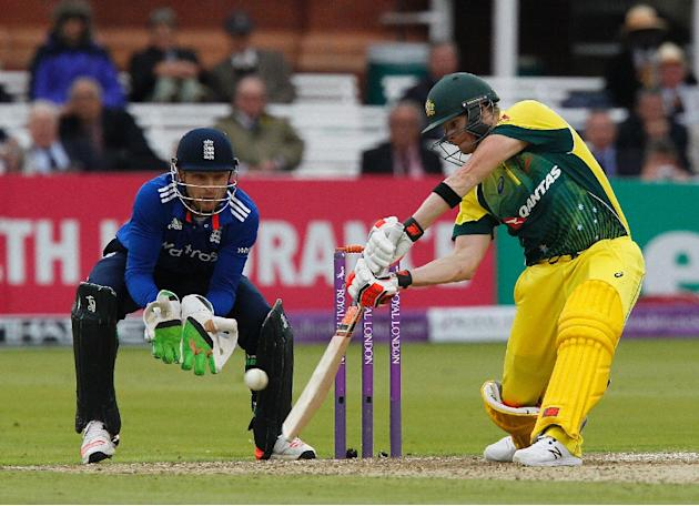 England's wicketkeeper Jos Buttler watches as Australia's captain Steven Smith plays a shot during the second one day international at Lord's in London, on September 5, 2015