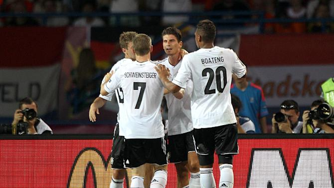 Mario Gomez (centre) has matched Alan Dzagoev's haul of three goals at Euro 2012