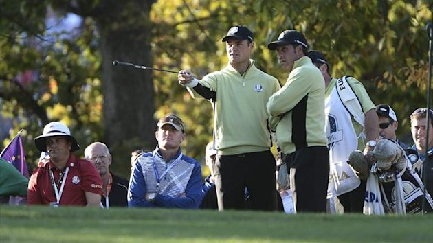 Martin Kaymer of Germany (L) talks with captain Jose Maria Olazabal