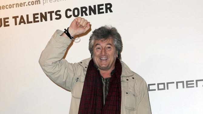 In this photo taken on Feb. 23, 2010, Vittorio Missoni poses for photographers in Milan, Italy. The search resumed Saturday, Jan. 5, 2013 for a small plane that has disappeared off the Venezuelan coast with six people aboard, including Vittorio Missoni, a top executive in Italy's Missoni fashion house, officials said. Vittorio Missoni, 58, is the director general of the iconic brand and the eldest son of the company's founder. Flying with him on Friday's flight from Venezuela's Los Roques resort archipelago to Caracas, was Missoni's wife, Maurizia Castiglioni, two Italian friends of the couple, and a crew of two Venezuelans. (AP Photo/Gian Mattia d'Alberto, Lapresse)