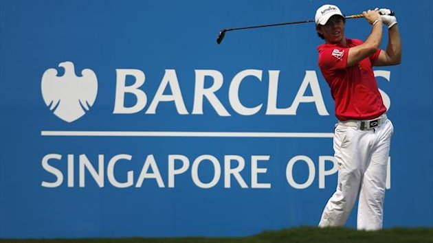 Rory McIlroy of Northern Ireland tees off on the 9th hole during the first round of the Barclays Singapore Open golf tournament in Sentosa (Reuters)