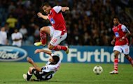 Braga's forward Lima fights for he ball with Udinese's defender Maurizio Domizi during their Champions League play-off second-leg football match at the Friuli stadium in Udine. Heartbreak befell Udinese in the Champions League play-off round for the second year running after they lost on penalties to Sporting Braga
