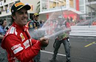 Fernando Alonso, pictured after the Monaco Grand Prix two weeks ago, believes this weekend's Canadian race will reveal Ferrari's potential to sustain their fight for world championship glory
