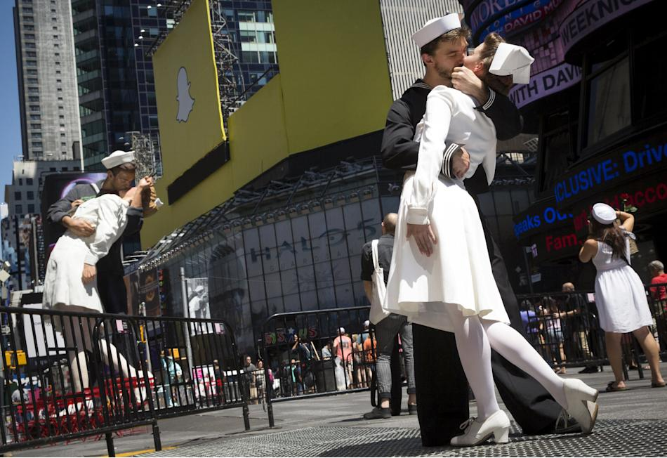 Actors reenact the famous picture of a sailor kissing a nurse on the 70th anniversary of Victory over Japan Day, near a replica sculpture in New York's Times Square