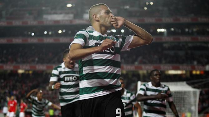 Sporting's Islam Slimani, center, from Algeria celebrates with teammates after scoring their team's third and equaliser goal against Benfica during a Portugal Cup soccer match between Benfica and Sporting at Benfica's Luz stadium in Lisbon, Saturday, Nov. 9, 2013