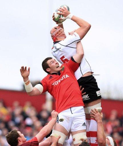 Munster's Wian du Preez (L) vies for the ball during a lineout with Ulster's Dan Tuohy (R)