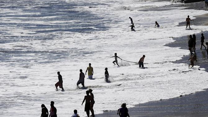 Beach goers enjoy the surf at Natural Bridges state beach in Santa Cruz, Calif., Thursday, June 27, 2013. (AP Photo/Marcio Jose Sanchez)