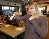 A fourth grade teacher is shown how to handle a firearm by an instructor at a concealed-weapons training class to 200 Utah teachers on December 27, 2012 in West Valley City, Utah. Several US states are considering allowing school teachers to carry weapons, and educators, determined not to allow a repeat of the Newtown massacre, are flocking to training sessions