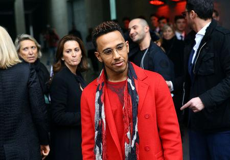 Formula One driver Hamilton of Britain arrives before Emporio Armani Autumn/Winter 2017 women collection show during Milan's Fashion Week in Milan