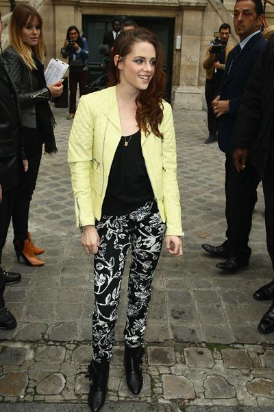 Kristen Stewart strikes a pose (and gives photoraphers a rare smile) in Paris just before the Balenciaga Spring 2013 show in Paris, France, Sept. 27. The young actress stayed loyal to her friend, desi