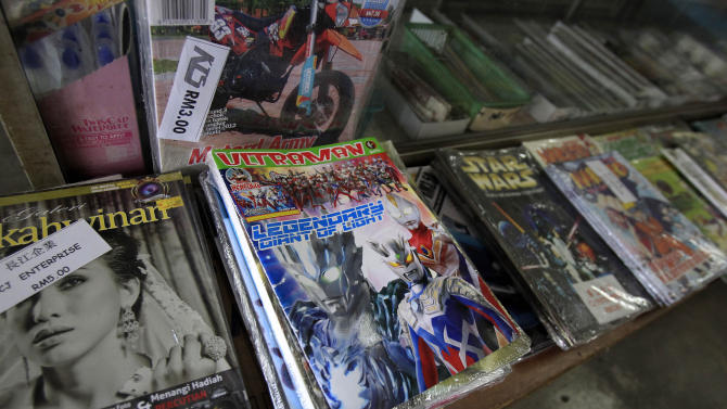 """An Ultraman comic book is on display for sale at a book store in Port Klang, outside Kuala Lumpur, Malaysia, Friday, March 7, 2014. Malaysia has banned an Ultraman comic book because it uses the word """"Allah"""" to describe the Japanese action hero. The Home Ministry said in a statement Friday that the Malay-edition of """"Ultraman, The Ultra Power"""" contained elements that can undermine public security and societal morals. (AP Photo/Lai Seng Sin)"""