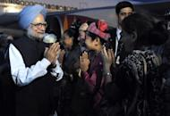 This photo, released by the Indian Press Information Bureau, shows Indian Prime Minister, Dr Manmohan Singh (L) pictured on his arrival at the international airport in Naypyidaw, on May 27. Singh is in Myanmar on a state visit and is the first Indian PM to visit the country in a quarter of a century