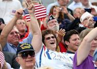 Republican supporters of Mitt Romney cheer as he speaks during a campaign rally in Norfolk, Virginia