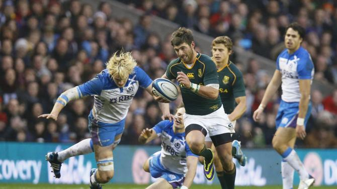 South Africa's Willie le Roux makes the break to score a try against Scotland, during their rugby union match in Edinburgh