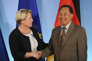 Thailand's Foreign Minister Kasit Piromya (R) shakes hands with German foreign undersecretary Cornelia Pieper at the foreign ministry. The ministers held talks on the impounding of an aircraft owned by the Thai crown, but the German government insisted that it was a matter for the courts
