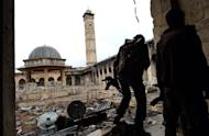 Syrian rebels patrol Aleppo's Umayyad Mosque on April 16, 2013