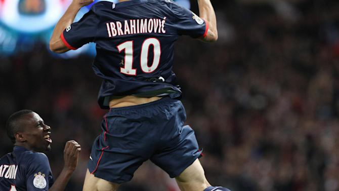 Paris Saint Germain's forward Zlatan Ibrahimovic from Sweden, center, jumps as he celebrates with Paris Saint Germain's midfielder Blaise Matudi, after scoring a goal, during his French League One soccer match against Monaco, at the Parc des Princes stadium, in Paris, Sunday, Sept. 22, 2013